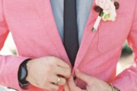 a bright pink blazer, a grey shirt and a blakc tie for a bold and unique summer groom's look