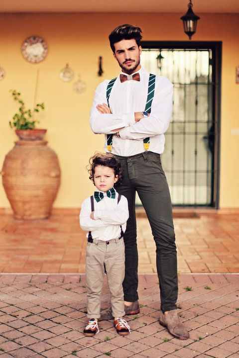 a chic duble look with striped suspenders, white shirts, pants and suede shoes for the groom