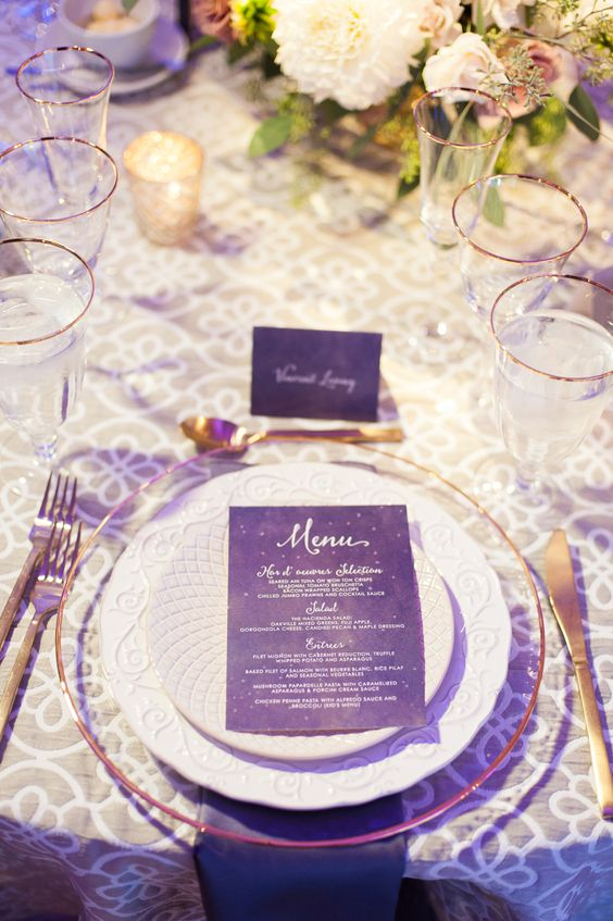 a chic purple and gold wedding tablescape with lush neutral florals