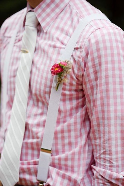 a colorful rustic summer look with a printed plaid shirt, a creamy striped tie, creamy suspenders and a bright boutonniere