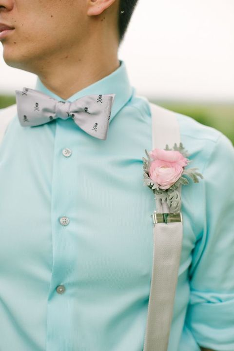 a creative and fresh spring look with a turquoise shirt, neutral suspenders and a printed skull bow tie for a touch of whimsy