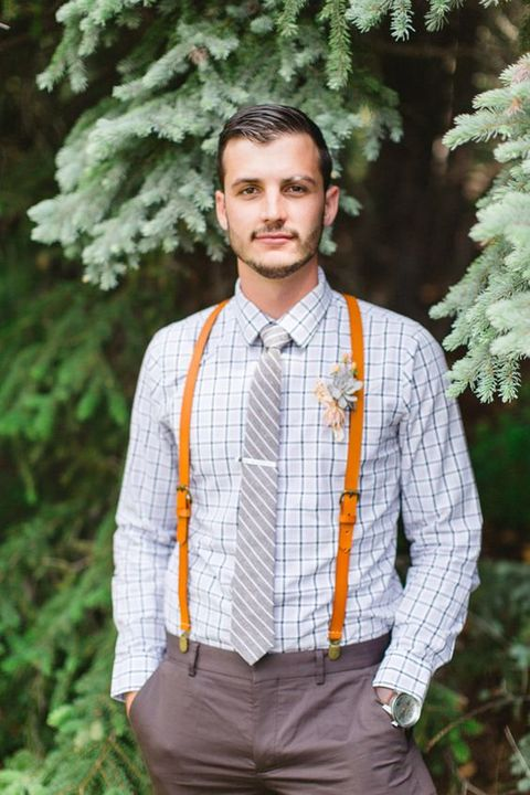 a creative look with a windowpane shirt, a striped tie, brown pants and orange leather suspenders
