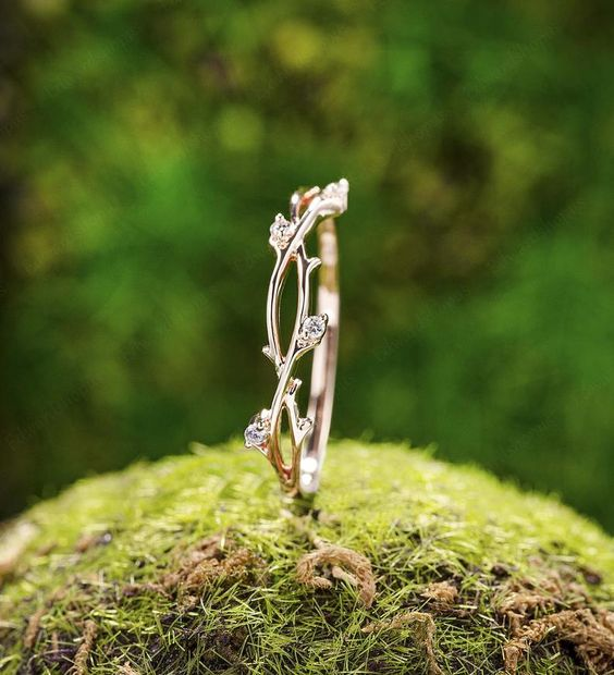 a fantastic gold and diamong woven branch wedding band is pure art worthy of elvish goldsmiths