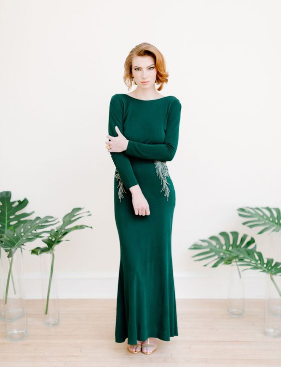 a fitting emerald wedding dress with a high neckline, long sleeves and gold embroidery