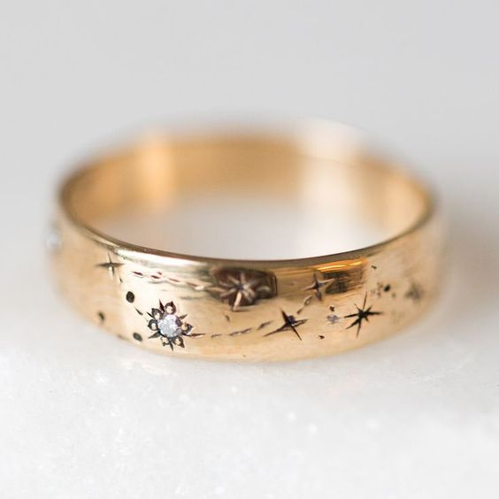 a gold and diamond star wedding band that can feature your zodiac signs is amazing