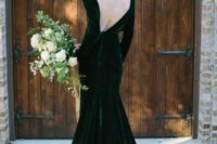 a gorgeous emerald green velvet wedding dress with a mermaid silhouette and a cutout back plus long sleeves