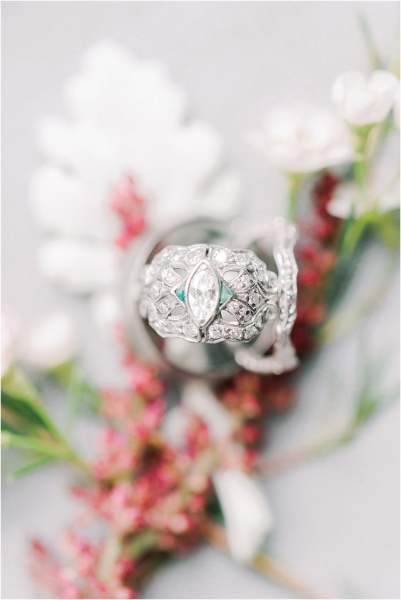 a jaw-dropping vintage white gold and diamond plus emeralds wedding band is a fantastic idea