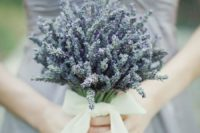 a lavender wedding bouquet with a large neutral bow of ribbon is a chic and dreamy idea