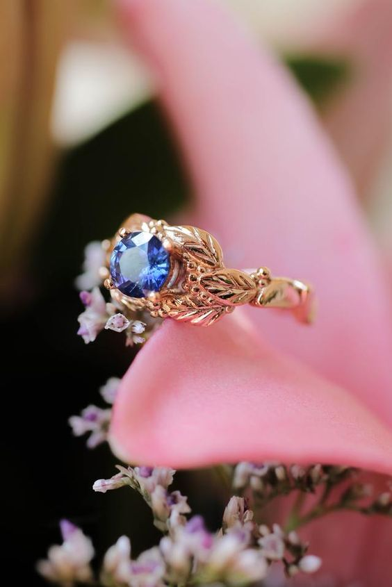 a leaves and grain sapphire engagement ring is a very beautiful idea that will add a bit of color