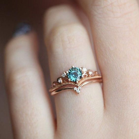 a lovely vintage engagement ring with an emerald and diamonds is a gorgeous idea for those who enjoy refined pieces