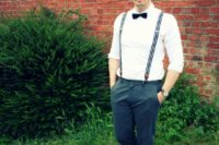 a monochromatic look with a white shirt, striped suspenders, a black bow tie and grey pants