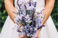 a puple and lilac wedding bouquet with a beautiful structure