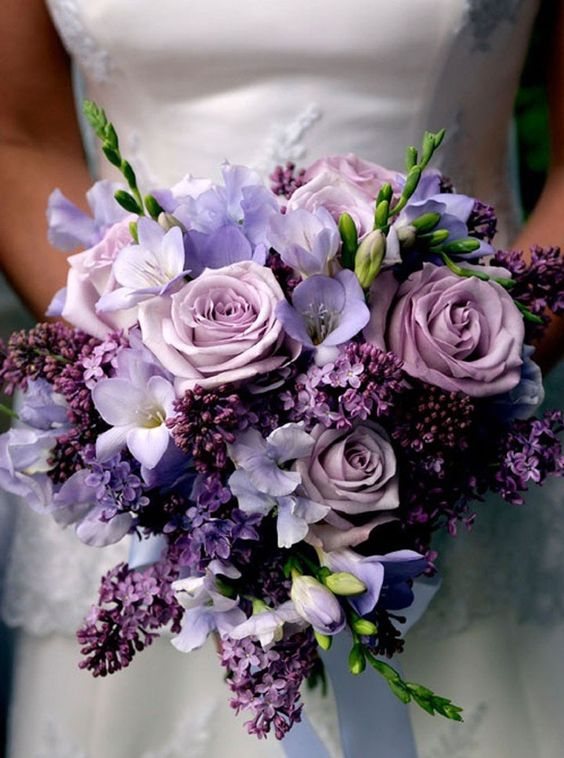 a purple and lilac wedding bouquet features different shades of purple