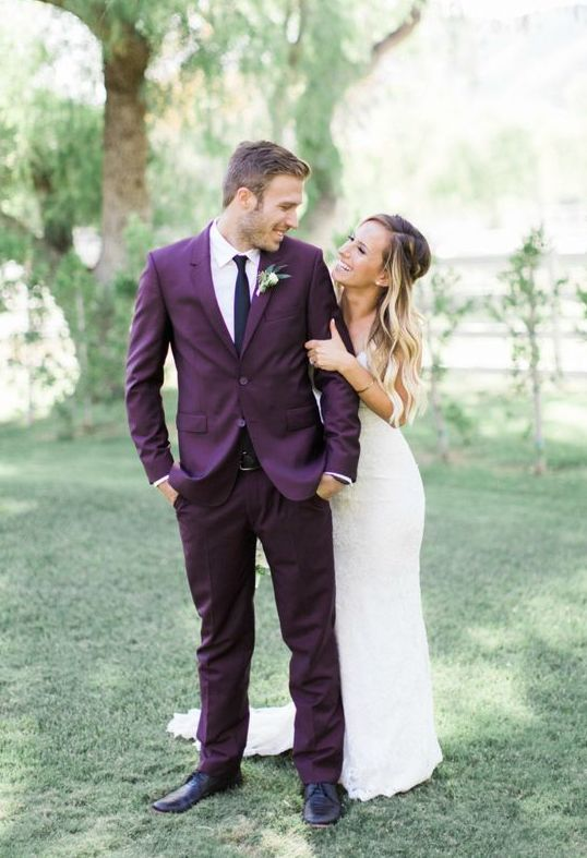 a purple groom suit with a thin black tie and black shoes is a gerat alternative to traditional black or grey