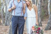 a rustic groom's look with a blue shirt, grey pants, striped suspenders, brown shoes for a simple and casual look