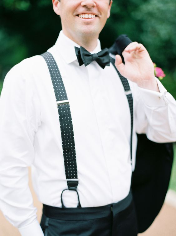 a stylish look with a tuxedo, printed suspenders and a black bow tie is timeless elegance