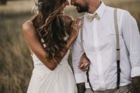 a summer groom's look with grey pants, a printed bow tie, striped suspenders is a stylish idea