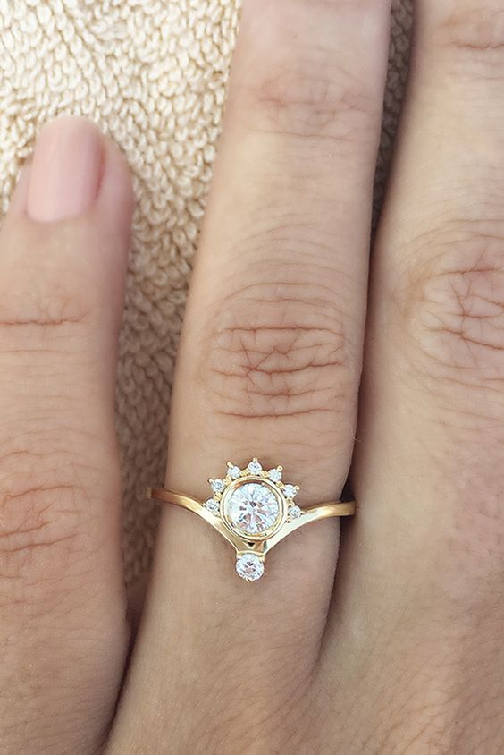 a vintage gold and diamond engagement ring of a creative shape will accent your hand and will stand out a lot