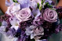a wedding bouquet in ths shades of purple and lilac looks very soft and romantic