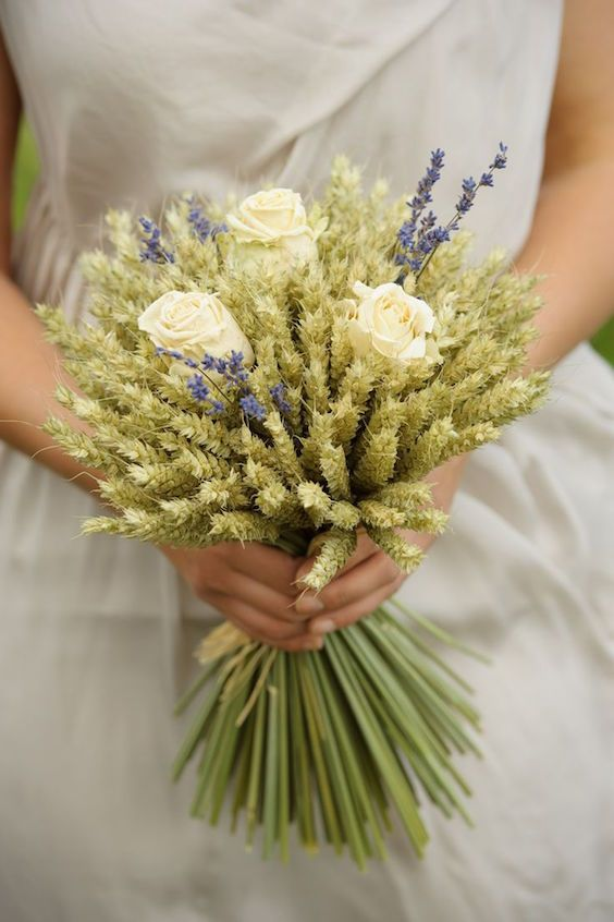 a wheat wedding bouquet with three creamy roses and some lavender is a very rustic idea