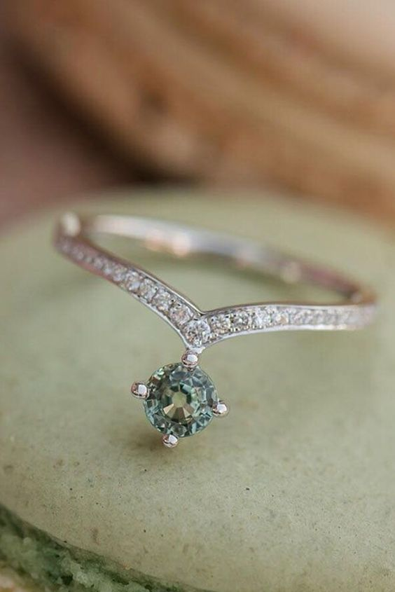 a whimsical white gold and diamond engagement ring shaped as a necklace is an out of the box idea