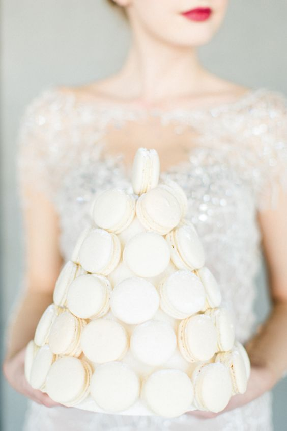 a white macaron tower is a glam and chic substitute to a usual wedding cake