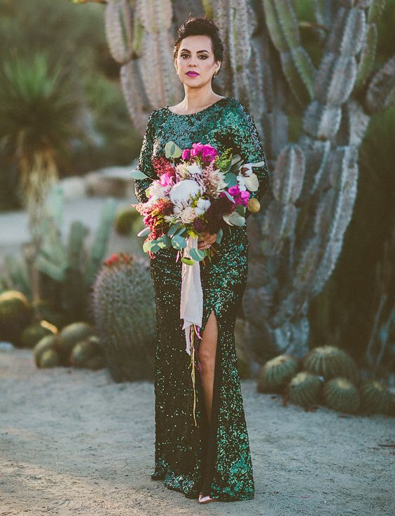 an emerald sequin maxi gown with long sleeves and a front slit is a bold choice for a modern bride