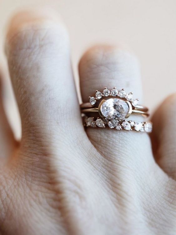 beautiful art deco wedding and engagement rings stacked create a bold and very refined look