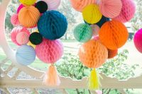 colorful honeycomb paper pompoms with tassels are amazing for wedding decor anywhere