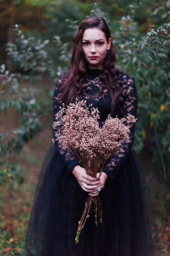 dried branches wedding bouquet for a moody or Halloween bride is a very whimsical idea