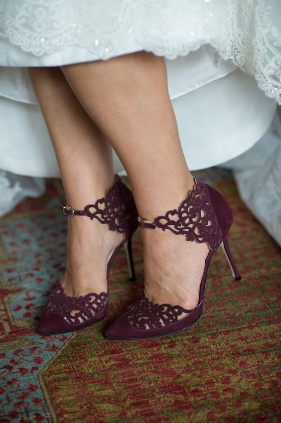 elegant beautiful purple heeled shoes with curlicue cutouts and front buckle