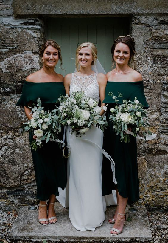 emerald off the shoulder midi dresses for bridesmaids and metallic shoes will give your gals a chic look