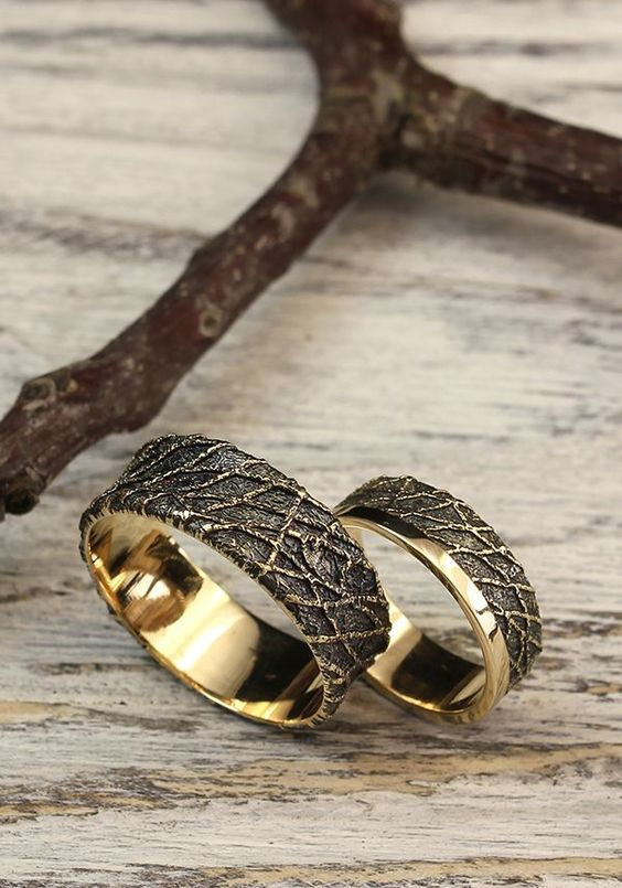 gold and black chaos wedding bands are gorgeous and look very out of the box