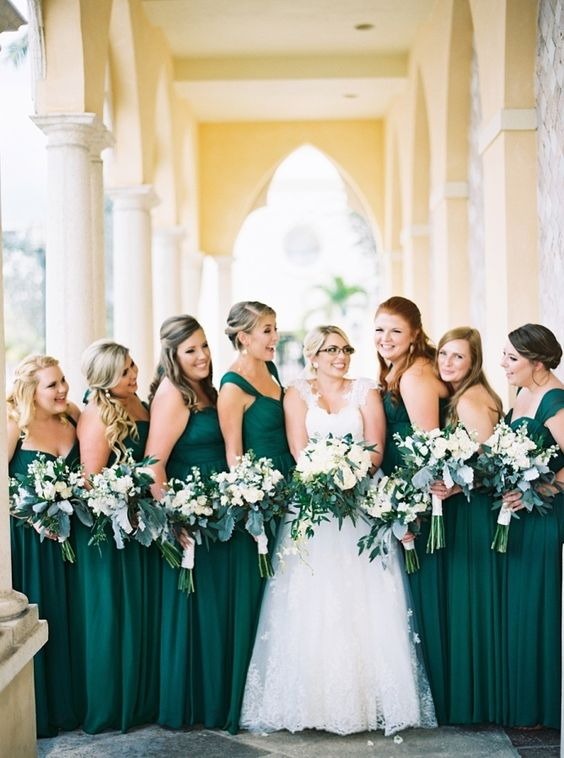 mismatching emerld maxi gowns for the bridesmaids, various neckline but the same color