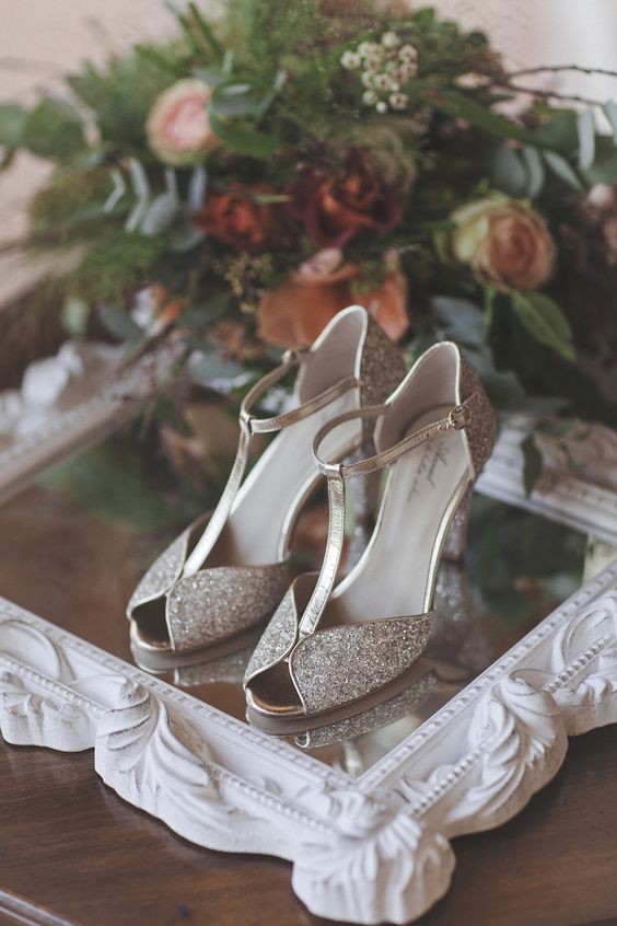 retro-inspired silver glitter shoes with T-straps are a chic and sophisticated idea for every bride