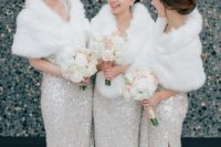 silver sequin maxi bridesmaid dresses with side slits, nude shoes and faux fur wraps for winter bridesmaids