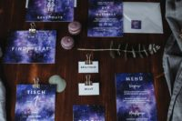 ultra violet galaxy wedding stationery with white envelopes looks just amazing