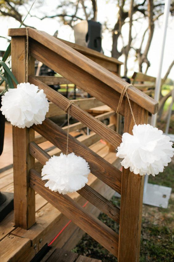 white paper pompoms accenting the stairs to make it look fresh and bright