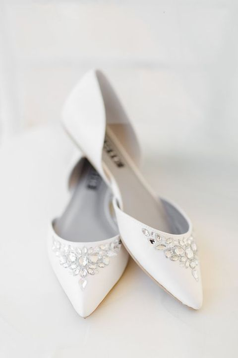 white wedding flats decorated with large rhinestones are amazing for a refined winter bridal look