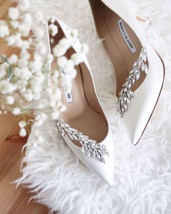 white wedding shoes with rhinestone detailing are amazing for a glam winter bride
