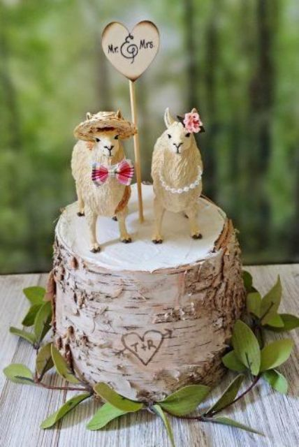 a birch bark wedding cake topped with two funny alpacas and a plywood heart is a lovely idea for a quirky wedding