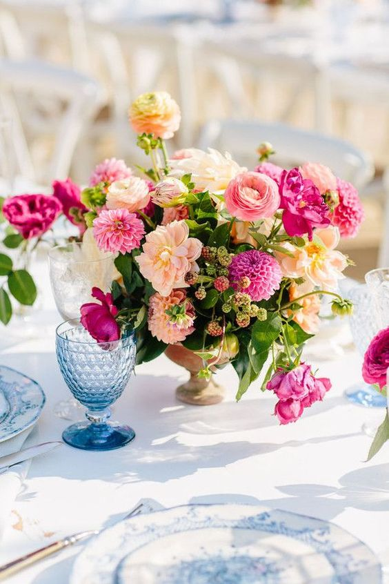 a bold spring wedding centerpiece in blush, light pink and fuchsia in a vintage bowl