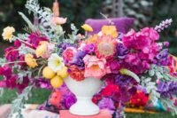 a bold spring wedding centerpiece in hot pink, purple, yellow and with lemons looks wow