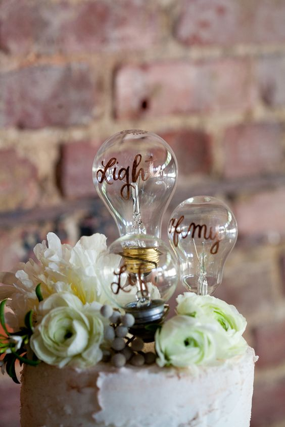 a buttercream wedding cake with fresh white blooms, berries and simple bulb cake toppers is a great idea for an industrial wedding