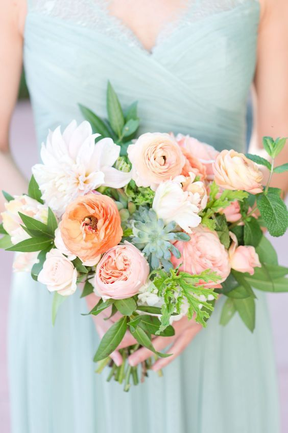 a chic bridesmaid bouquet with creamy, blush and coral blooms and greenery and succulents