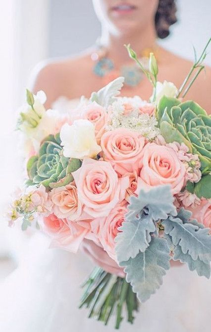a chic wedding bouquet with mint leaves and succulents, coral and creamy blooms for a bride