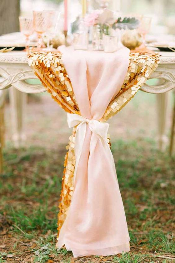 a gold sequin and light pink wedding table table runners will create a romantic and glam look