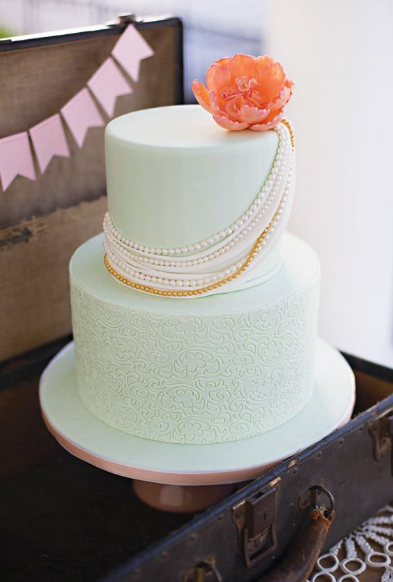 a patterned mint wedding cake with edible beads and a flower is a cool and bright idea for a wedding