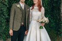 a retro-inspired wedding dress with a lace bodice, a full skirt, a silk collar, white shoes and a veil