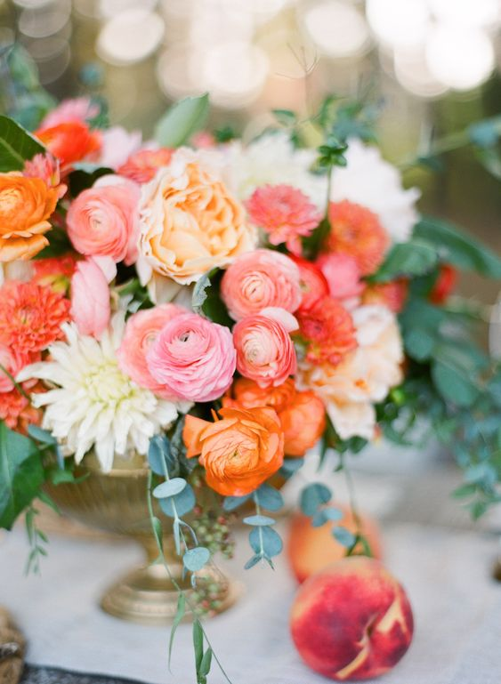 a romantic bright spring wedding centerpiece in pink, orange, white, light pink and peachy shades